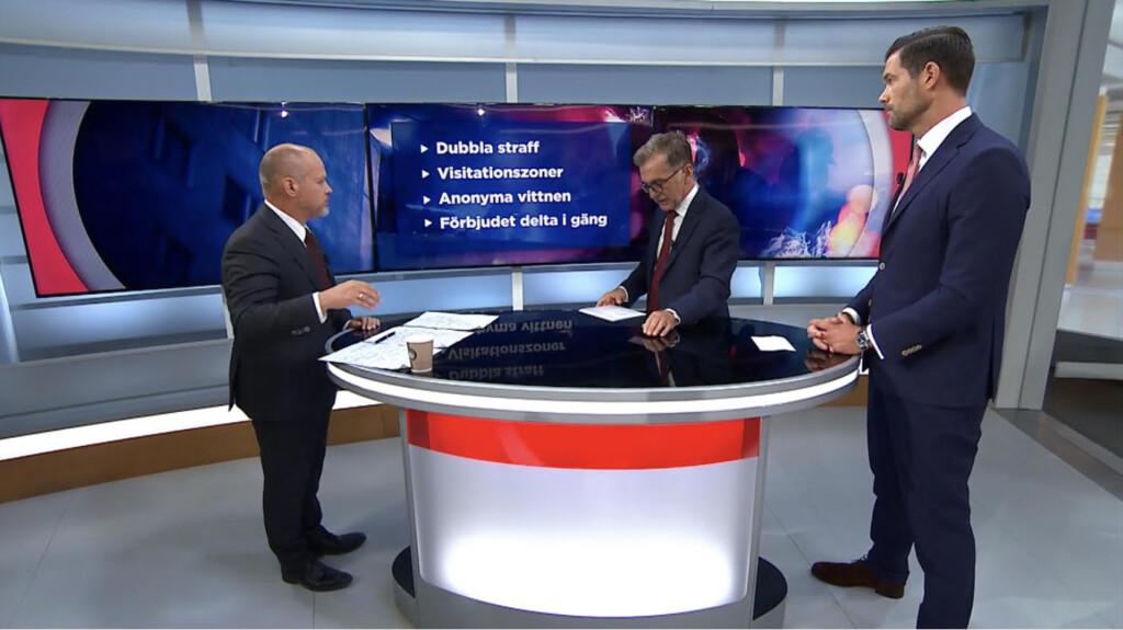 Morgan Johansson och Johan Forssell i debatt under ledning av Ulf Kristoffersson. Foto: TV 4.